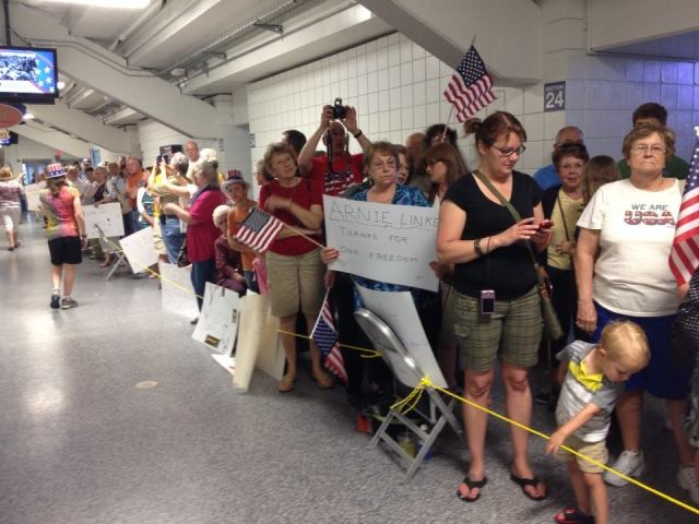 Community members welcome World War II veterans home from their Honor Flight May 31, 2014